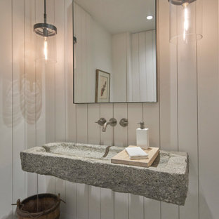 Photo of a medium sized rural cloakroom in Chicago with white walls, slate flooring, a trough sink, granite worktops, grey floors, grey worktops, a floating vanity unit and tongue and groove walls.