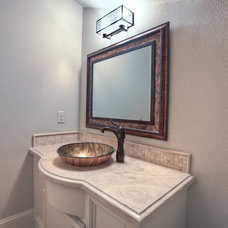 Traditional Powder Room by The Reyna Realty Group