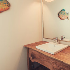 Rustic Powder Room by 2Hills Renovation