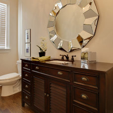 Traditional Powder Room by Otrada LLC