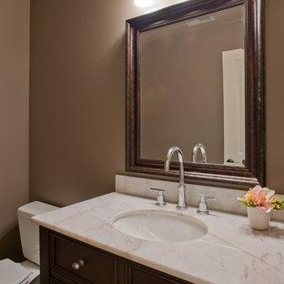 シアトルのトラディショナルスタイルのおしゃれなトイレ・洗面所 (ピンクの洗面カウンター) の写真