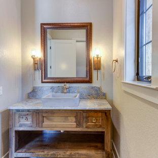 Стильный дизайн: туалет среднего размера в стиле рустика с фасадами в стиле шейкер, коричневыми фасадами, раздельным унитазом, серой плиткой, керамической плиткой, серыми стенами, полом из керамогранита, настольной раковиной, столешницей из гранита, серым полом, серой столешницей, напольной тумбой и деревянными стенами - последний тренд