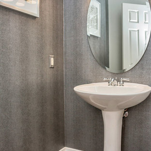 Inspiration for a small contemporary ceramic floor powder room remodel in Sacramento with gray walls and a pedestal sink