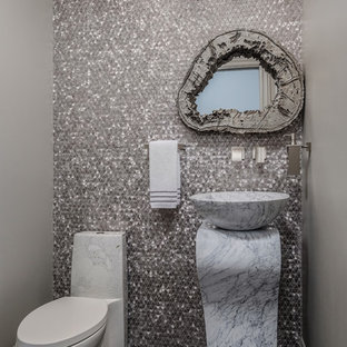 Design ideas for a mediterranean cloakroom in San Francisco with a one-piece toilet, multi-coloured tiles, mosaic tiles, grey walls, a vessel sink, marble worktops, multi-coloured floors and white worktops.