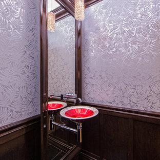 Exemple d'un petit WC et toilettes tendance avec un lavabo suspendu, un WC suspendu, un carrelage noir, un carrelage de pierre et un mur gris.
