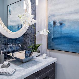 На фото: с высоким бюджетом маленькие туалеты в стиле современная классика с плоскими фасадами, серыми фасадами, синей плиткой, плиткой мозаикой, белыми стенами, настольной раковиной, столешницей из кварцита и белым полом