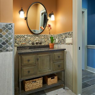 This is an example of a classic cloakroom in New York with distressed cabinets, beige tiles, slate flooring, granite worktops, multi-coloured floors and grey worktops.