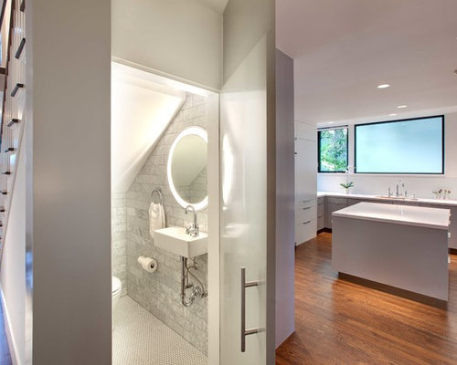 trendy gray tile and marble tile powder room photo in houston with a wall mount