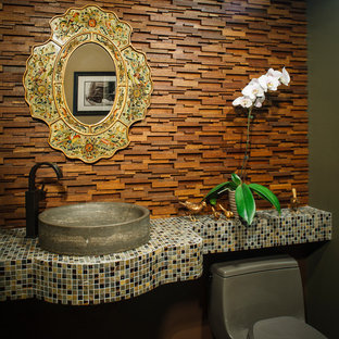 Example of a trendy powder room design in New York with a vessel sink and tile countertops