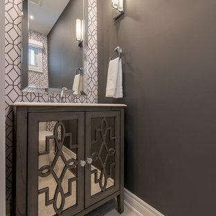 На фото: маленький туалет в современном стиле с стеклянными фасадами, серыми фасадами, унитазом-моноблоком, серыми стенами, полом из керамической плитки, врезной раковиной, столешницей из искусственного камня и бежевым полом