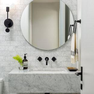 Idee per un bagno di servizio design di medie dimensioni con nessun'anta, ante grigie, WC monopezzo, piastrelle grigie, piastrelle in pietra, pareti bianche, pavimento in marmo, lavabo sottopiano, top in marmo, pavimento grigio e top grigio