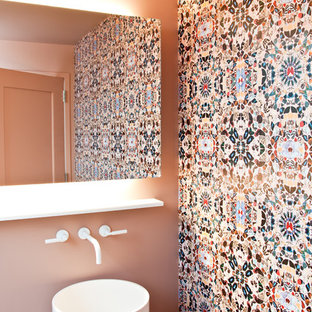 Contemporary cloakroom in New York with a pedestal sink, multi-coloured tiles and mosaic tiles.