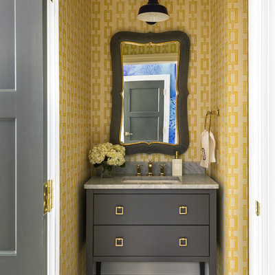 Powder room - transitional marble floor powder room idea in Little Rock with an undermount sink, yellow walls and gray countertops