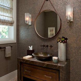 Foto de aseo contemporáneo, de tamaño medio, con lavabo sobreencimera, armarios tipo mueble, baldosas y/o azulejos marrones, baldosas y/o azulejos en mosaico, encimera de granito, suelo de travertino, puertas de armario de madera en tonos medios y encimeras marrones