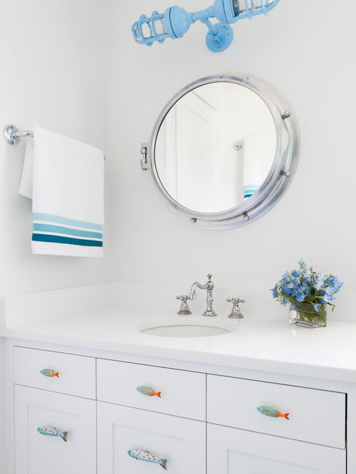 Beach Style Powder Room Idea In New York With An Undermount Sink, Shaker  Cabinets And