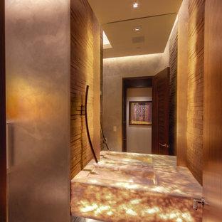 Foto di un bagno di servizio minimalista con lavabo integrato, top in onice, piastrelle grigie, piastrelle in pietra e pavimento in pietra calcarea