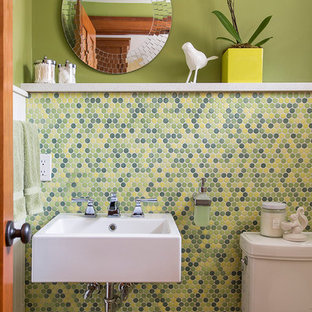 Inspiration for a small contemporary cloakroom in Minneapolis with a wall-mounted sink, a two-piece toilet, multi-coloured tiles, mosaic tiles, green walls and mosaic tile flooring.