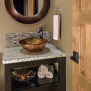Inspiration for a transitional powder room remodel in Omaha with a vessel sink