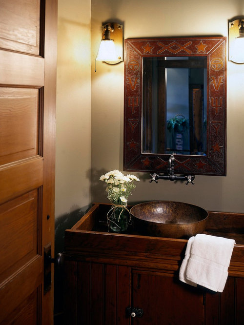 Example Of A Mountain Style Powder Room Design In Omaha With A Vessel Sink