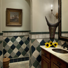 Mediterranean Powder Room by Tommy Chambers Interiors, Inc.