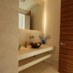На фото: туалет в стиле модернизм с плиткой из известняка с