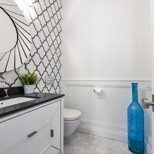 Exemple d'un WC et toilettes chic de taille moyenne avec un placard avec porte à panneau encastré, des portes de placard blanches, un mur blanc, un sol en marbre, un lavabo encastré, un plan de toilette en quartz modifié, un sol gris et un plan de toilette noir.