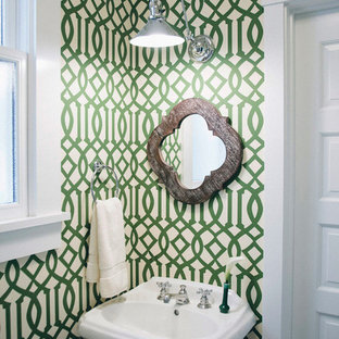Design ideas for a small transitional powder room in San Francisco with a pedestal sink and green walls.