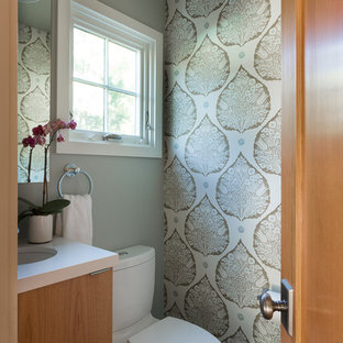 Inspiration for a small traditional cloakroom in San Francisco with a submerged sink, flat-panel cabinets, medium wood cabinets, quartz worktops, a two-piece toilet, grey walls and slate flooring.