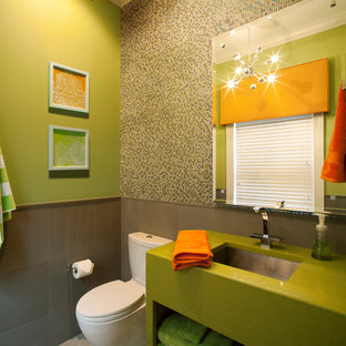 Example of a trendy mosaic tile powder room design in Jacksonville with an undermount sink, open cabinets and a two-piece toilet