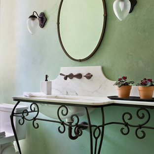 Mediterranean cloakroom in Los Angeles with a console sink, green walls and white worktops.