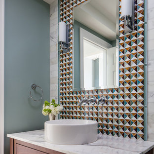 Photo of a traditional cloakroom in San Francisco with a vessel sink, flat-panel cabinets, dark wood cabinets, multi-coloured tiles and blue walls.