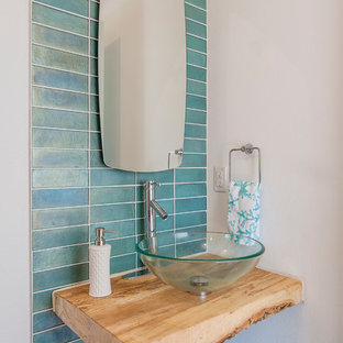 Inspiration for a contemporary blue tile powder room remodel in Dallas with a vessel sink, wood countertops, multicolored walls and brown countertops