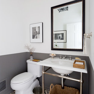 Tuscan multicolored floor powder room photo in Los Angeles with multicolored walls and a console sink