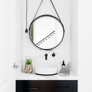 Inspiration for a scandinavian powder room in Melbourne with shaker cabinets, brown cabinets, white walls, a vessel sink and marble benchtops.