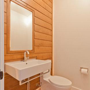 Ispirazione per un piccolo bagno di servizio scandinavo con ante lisce, ante in legno scuro, WC a due pezzi, pareti bianche, pavimento in mattoni e lavabo sospeso