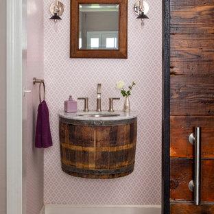 На фото: класса люкс туалеты среднего размера в современном стиле с фиолетовыми стенами, полом из бамбука, раковиной с несколькими смесителями, мраморной столешницей, коричневым полом и белой столешницей