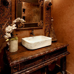 mediterranean powder room by Schultz Development Corp