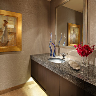 Photo of a medium sized modern cloakroom in Phoenix with a submerged sink, flat-panel cabinets, dark wood cabinets, granite worktops, beige tiles and limestone flooring.