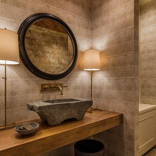ポートランドの小さいトラディショナルスタイルのおしゃれなトイレ・洗面所 (グレーの壁、ベッセル式洗面器、木製洗面台、ブラウンの洗面カウンター、グレーの床) の写真