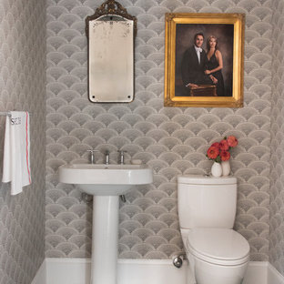 Photo of a classic cloakroom in Boston with a two-piece toilet, grey walls, a pedestal sink and green floors.