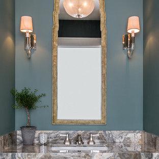Klassische Gästetoilette mit blauer Wandfarbe, Unterbauwaschbecken und bunter Waschtischplatte in Denver