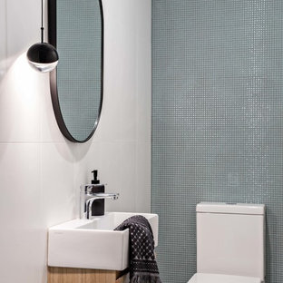 Design ideas for a small contemporary powder room in Sydney with a one-piece toilet, green tile, ceramic tile, white walls, porcelain floors, a wall-mount sink and grey floor.