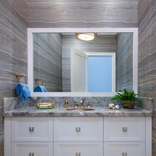 На фото: туалеты в стиле современная классика с фасадами с утопленной филенкой, белыми фасадами, серыми стенами, светлым паркетным полом, врезной раковиной, бежевым полом и серой столешницей