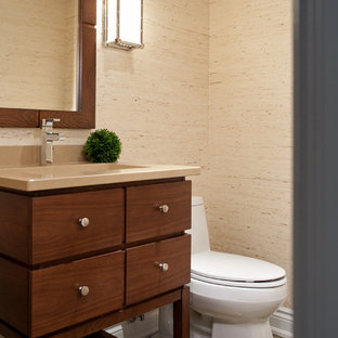 Design ideas for a small contemporary cloakroom in Toronto with a submerged sink, flat-panel cabinets, medium wood cabinets, engineered stone worktops, a one-piece toilet, beige walls and slate flooring.