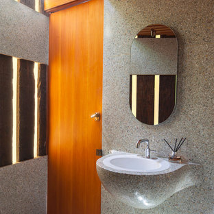 Example of a 1960s gray floor powder room design in Los Angeles with gray walls and a drop-in sink