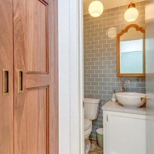 На фото: маленький туалет в стиле лофт с фасадами в стиле шейкер, белыми фасадами, раздельным унитазом, синей плиткой, стеклянной плиткой, белыми стенами, полом из керамогранита, настольной раковиной, столешницей из искусственного кварца, разноцветным полом и белой столешницей