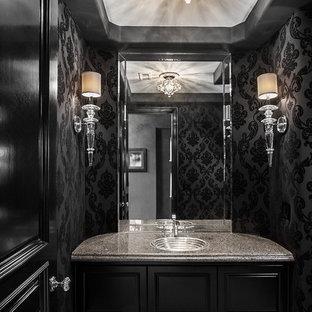 Foto de aseo contemporáneo con lavabo encastrado, puertas de armario negras, paredes negras y encimeras grises