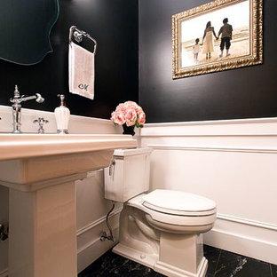 Ispirazione per un piccolo bagno di servizio chic con lavabo a colonna, WC a due pezzi, piastrelle nere e pareti nere
