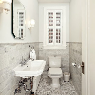 Small ornate black and white tile, gray tile and marble tile marble floor powder room photo in DC Metro with a wall-mount sink, a two-piece toilet and white walls