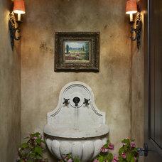 Mediterranean Powder Room by MQ Architecture & Design, LLC
